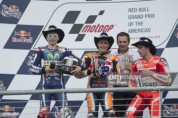 Jorge Lorenzo of Spain and Movistar Yamaha MotoGP Marc Marquez of Spain and Repsol Honda Team and Andrea Iannone of Italy and Ducati Team celebrate...