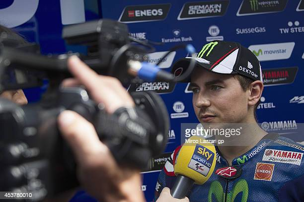 Jorge Lorenzo of Spain and Movistar Yamaha MotoGP speaks with journalists during the MotoGp Tests in Brno at Brno Circuit on August 18 2014 in Brno...