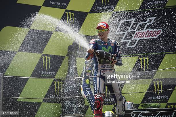 Jorge Lorenzo of Spain and Repsol Honda Team celebrates his victory with champagne on the podium at the end of the MotoGP race during the MotoGp of...