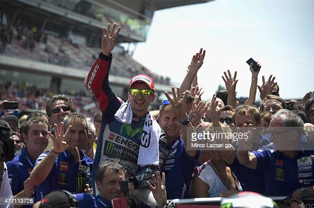 Jorge Lorenzo of Spain and Repsol Honda Team celebrates the victory under the podium with team at th end of the MotoGP race during the MotoGp of...