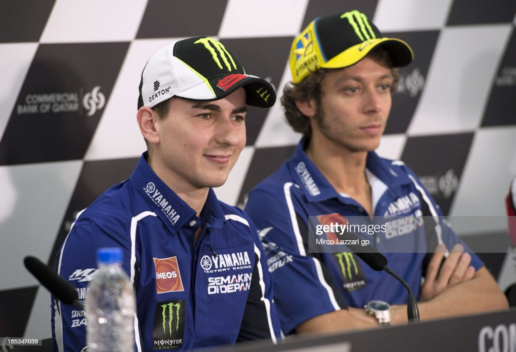 <a gi-track='captionPersonalityLinkClicked' href=/galleries/search?phrase=Jorge+Lorenzo&family=editorial&specificpeople=543869 ng-click='$event.stopPropagation()'>Jorge Lorenzo</a> of Spain and Yamaha Factory Racing and <a gi-track='captionPersonalityLinkClicked' href=/galleries/search?phrase=Valentino+Rossi&family=editorial&specificpeople=157603 ng-click='$event.stopPropagation()'>Valentino Rossi</a> of Italy and Yamaha Factory Racing (R) look on during the press conference pre-event during MotoGp of Qatar at Losail Circuit on April 3, 2013 in Doha, Qatar.