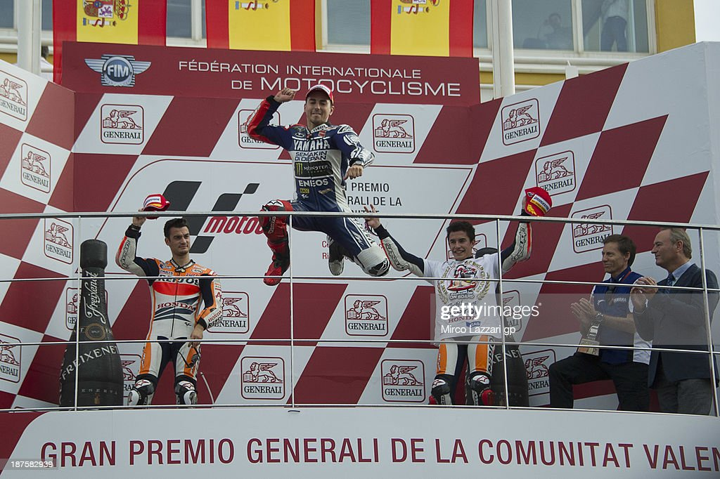 <a gi-track='captionPersonalityLinkClicked' href=/galleries/search?phrase=Jorge+Lorenzo&family=editorial&specificpeople=543869 ng-click='$event.stopPropagation()'>Jorge Lorenzo</a> of Spain and Yamaha Factory Racing celebrates the MotoGP victory on the podium after the MotoGP race during the MotoGP of Valencia - Race at Ricardo Tormo Circuit on November 10, 2013 in Valencia, Spain.