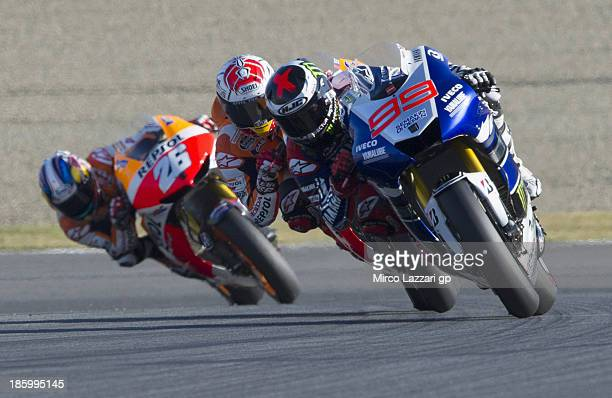 Jorge Lorenzo of Spain and Yamaha Factory Racing leads the field ahead of Marc Marquez of Spain and Repsol Honda team and Dani Pedrosa of Spain and...