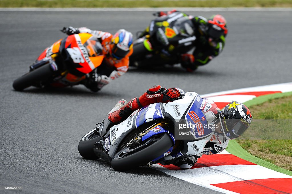 <a gi-track='captionPersonalityLinkClicked' href=/galleries/search?phrase=Jorge+Lorenzo&family=editorial&specificpeople=543869 ng-click='$event.stopPropagation()'>Jorge Lorenzo</a> of Spain and Yamaha Factory Racing Team leads Dani Pedrosa of Spain and Repsol Honda Team and <a gi-track='captionPersonalityLinkClicked' href=/galleries/search?phrase=Andrea+Dovizioso&family=editorial&specificpeople=559970 ng-click='$event.stopPropagation()'>Andrea Dovizioso</a> of Italy and Monster Yamaha Tech 3 Team for winning the MotoGP race at Circuit de Catalunya on June 3, 2012 in Montmelo, Spain. Lorenzo was first, Pedrosa second and Dovizioso third.