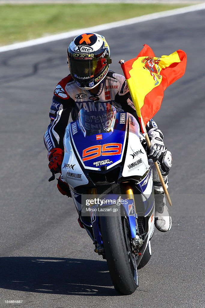 <a gi-track='captionPersonalityLinkClicked' href=/galleries/search?phrase=Jorge+Lorenzo&family=editorial&specificpeople=543869 ng-click='$event.stopPropagation()'>Jorge Lorenzo</a> of Spain and Yamaha Factory Team celebrates with the Spanish flag after achieving second place and overall victory in the MotoGp Championship at the end the Australian MotoGP, round 17 of the MotoGP World Championship, at Phillip Island Grand Prix Circuit on October 28, 2012 in Phillip Island, Australia.