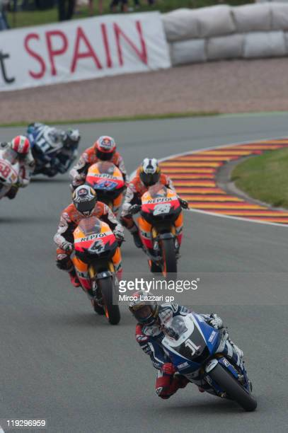 Jorge Lorenzo of Spain and Yamaha Factory Team leads the field during the MotoGP race of the MotoGP of Germany at Sachsenring Circuit on July 17 2011...
