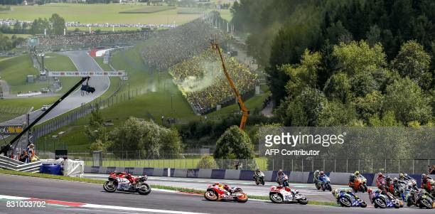 TOPSHOT Jorge Lorenzo of Spain Marc Marquez of Spain Andrea Dovizioso of Italy and Valentino Rossi of Italy race at the MotoGP Austrian Grand Prix...