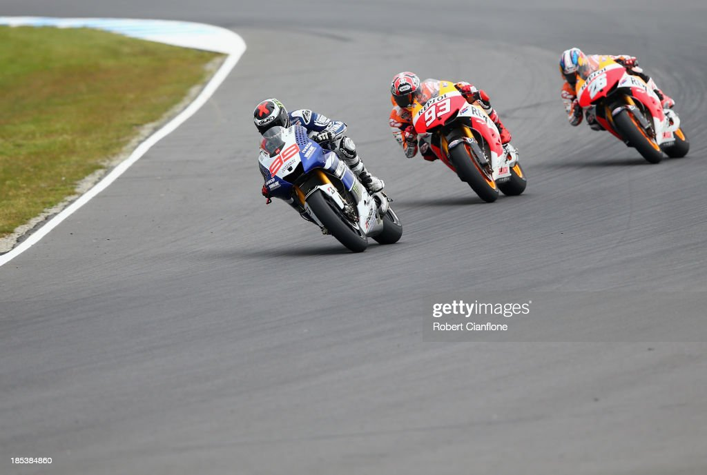 Jorge Lorenzo of Spain riding the #99 Yamaha Factory Racing Yamaha is chased by Marc Marquez and Dani Pedrosa both of Spain and the Repsol Honda Team during the Australian MotoGP race at Phillip Island Grand Prix Circuit on October 20, 2013 in Phillip Island, Australia.