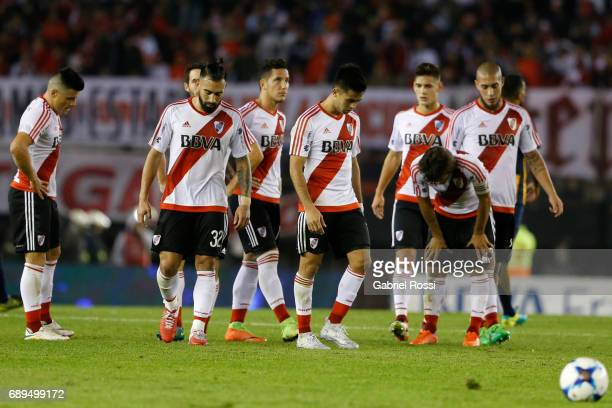 Jorge Luis Moreira Ariel Rojas Camilo Mayada Sebastian Driussi Leonardo Ponzio Jonathan Maidana and Gonzalo Martinez of River Plate leave the field...
