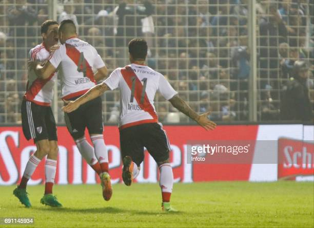 Jorge Luis Moreira of River Plate celebrates with teammates Ignacio Fernandez and Sebastian Driussi after scoring the first goal of his team during a...