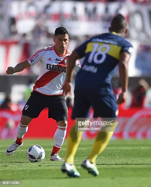 Jorge Luis Moreira of River Plate drives the ball followed by Frank Fabra of Boca Juniors during a match between River Plate and Boca Juniors as part...