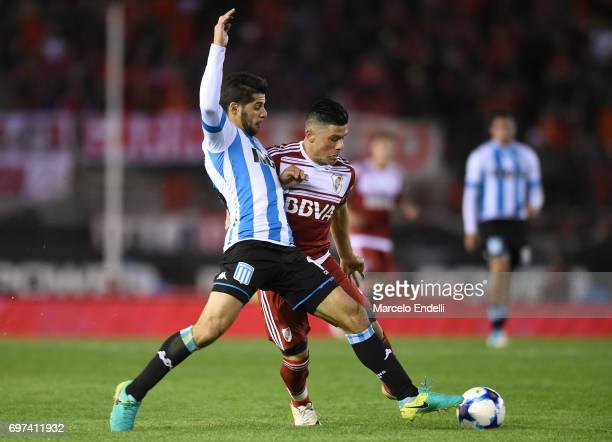 Jorge Luis Moreira of River Plate fights for the ball with Emiliano Insua of Racing Club during a match between River Plate and Racing Club as part...