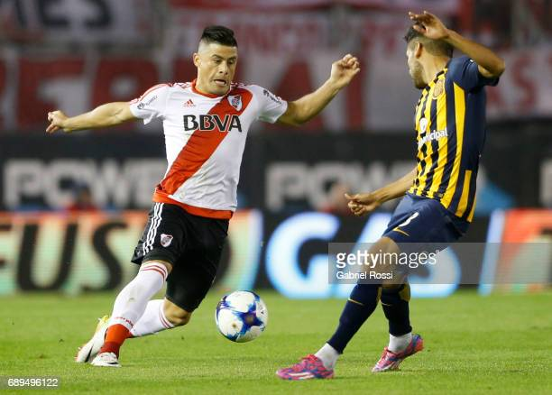 Jorge Luis Moreira of River Plate fights for the ball with Federico Carrizo of Rosario Central during a match between River Plate and Rosario Central...