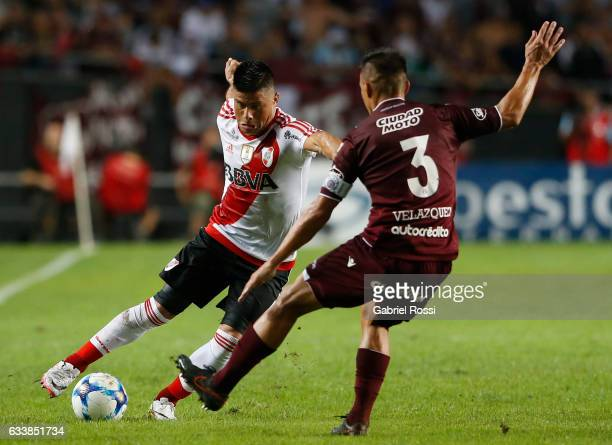 Jorge Luis Moreira of River Plate fights for the ball with Maximiliano Velazquez of Lanus during a match between River Plate and Lanus as part of...