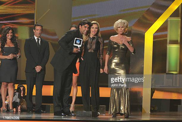 Jorge Luis Pila Aracely Arambula and Christian Bach on stage during Telemundo's Premios Tu Mundo Awards at American Airlines Arena on August 15 2013...