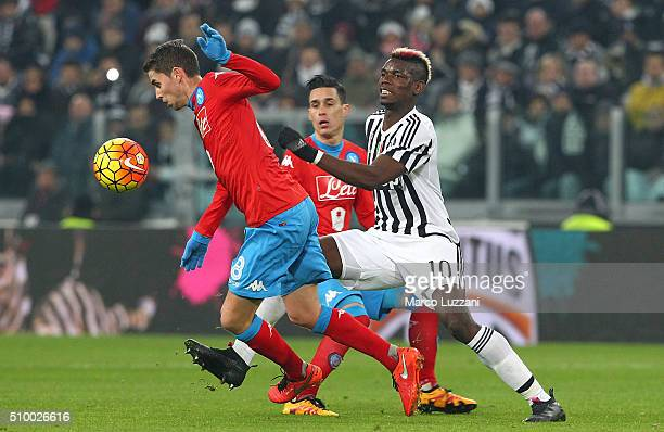 Jorge Luiz Frello Jorginho of SSC Napoli competes for the ball with Paul Pogba of Juventus FC during the Serie A match between and Juventus FC and...