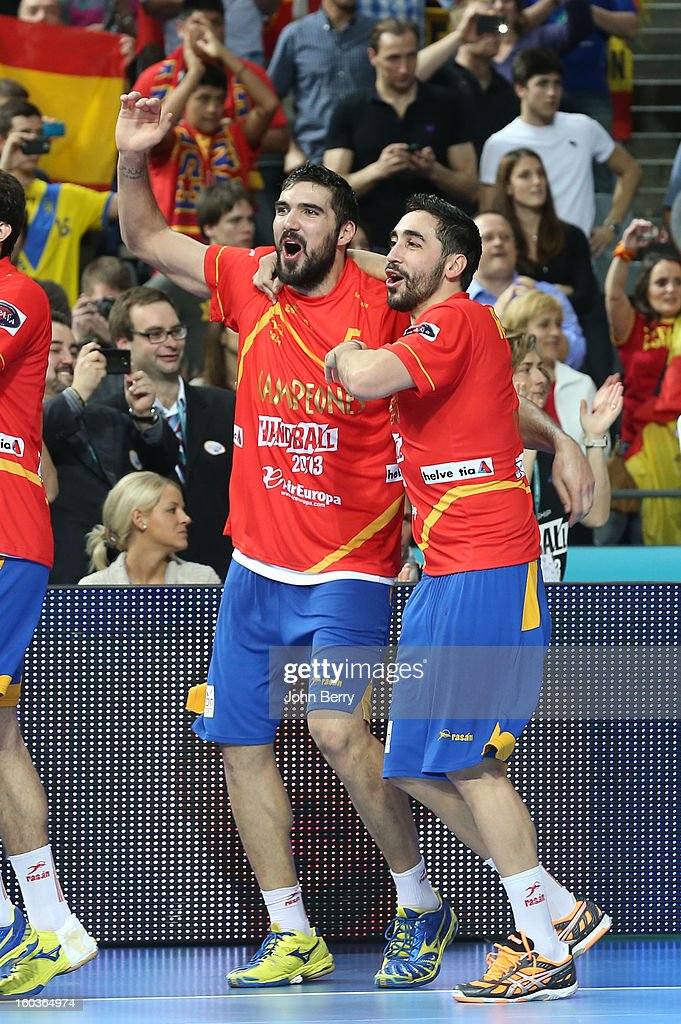 Jorge Maqueda and Valero Rivera of Spain celebrate their victory and their gold medal after the Men's Handball World Championship 2013 final match between Spain and Denmark at Palau Sant Jordi on January 27, 2013 in Barcelona, Spain.
