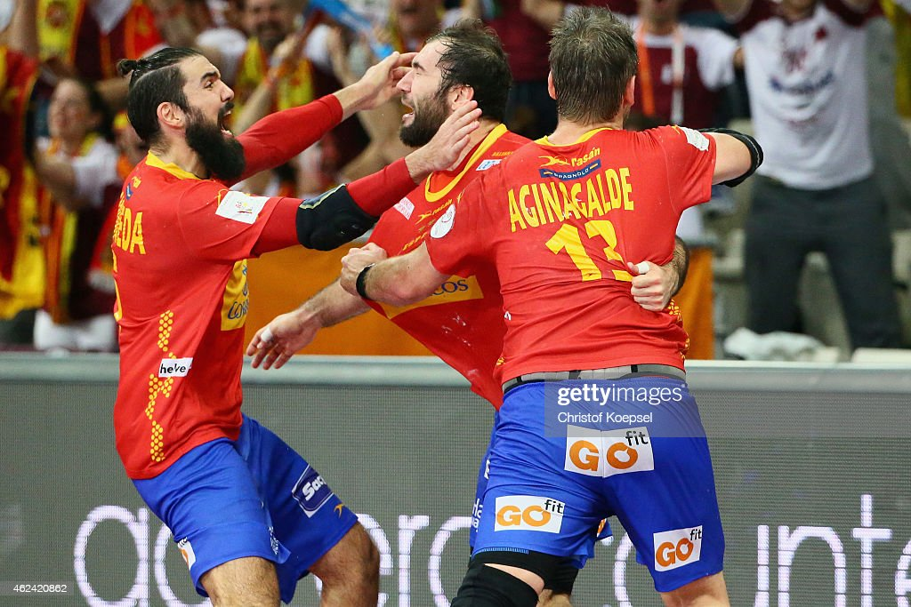 Jorge Maqueda, Joan Canellas and Julen Aguinagalde of Spain celebrate after winning the quarter final match between Spain and Denmark at Lusail Multipurpose Hall on January 28, 2015 in Doha, Qatar. The match between Denmark and Spain ended 24-25.