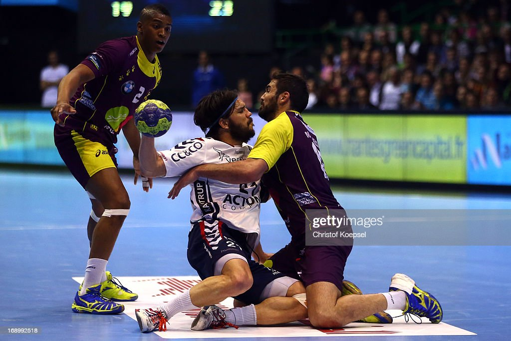 Jorge Maqueda of Nantes (R) defends against Jakob Green Jensen of Holstebro (C) during the EHF Cup Semi Final match between Tvis Holstebro and HBC Nantes at Palais des Sports de Beaulieu on May 18, 2013 in Nantes, France.
