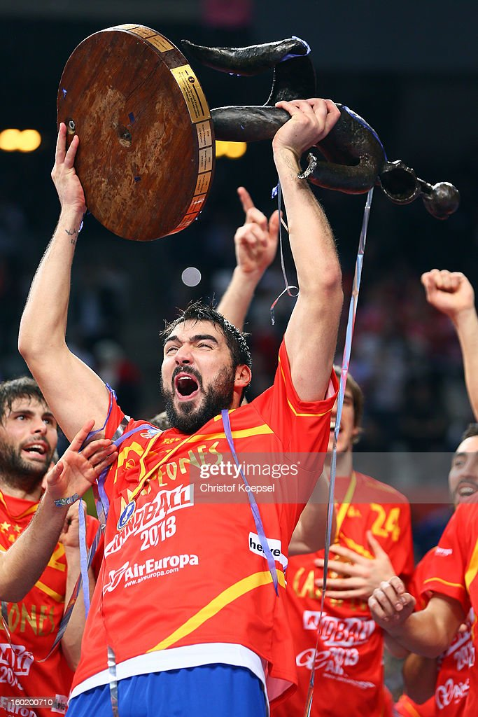 Jorge Maqueda of Spain lifts the cup after winning the Men's Handball World Championship 2013 final match between Spain and Denmark at Palau Sant Jordi on January 27, 2013 in Barcelona, Spain.