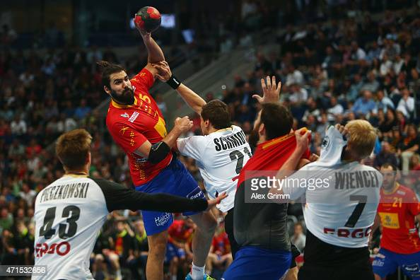 Jorge Maqueda Pena of Spain is challenged by Erik Schmidt of Germany during the European Handball Championship 2016 Qualifier match between Germany...