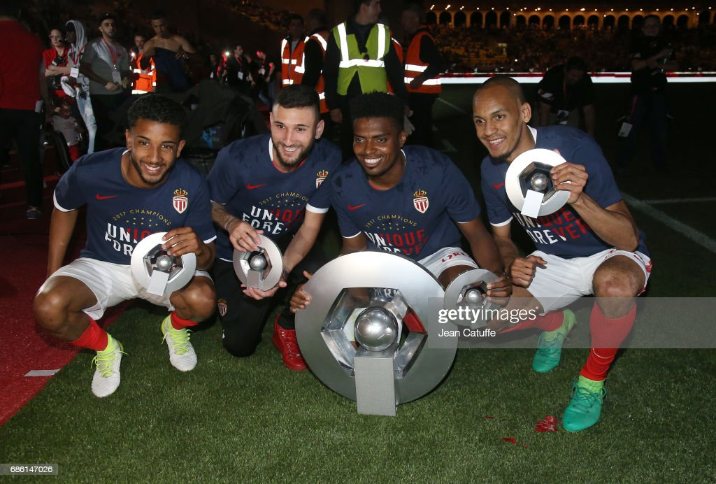 Jorge Marco de Oliveira Moraes, Gabriel Boschilia, Jemerson. Fabinho pose with the trophy of French League 1 champion following the French Ligue 1 match between AS Monaco and AS Saint-Etienne (ASSE) at Stade Louis II on May 17, 2017 in Monaco, Monaco.