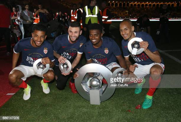 Jorge Marco de Oliveira Moraes Gabriel Boschilia Jemerson Fabinho pose with the trophy of French League 1 champion following the French Ligue 1 match...