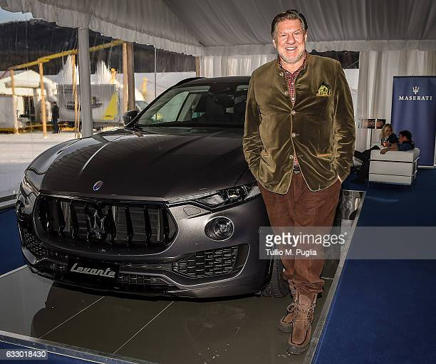 Jorge Marquardt poses near a Maserati Levante during Snow Polo World Cup St Morits 2017 on January 28 2017 in St Moritz Switzerland