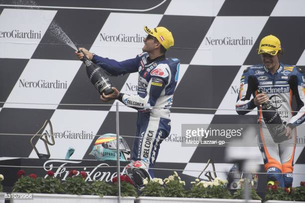 Jorge Martin of Spain and Del Conca Gresini Moto3 and Philipp Oettl of Germany and Sudmetal Schedl GP Racing celebrate on the podium at the end of...