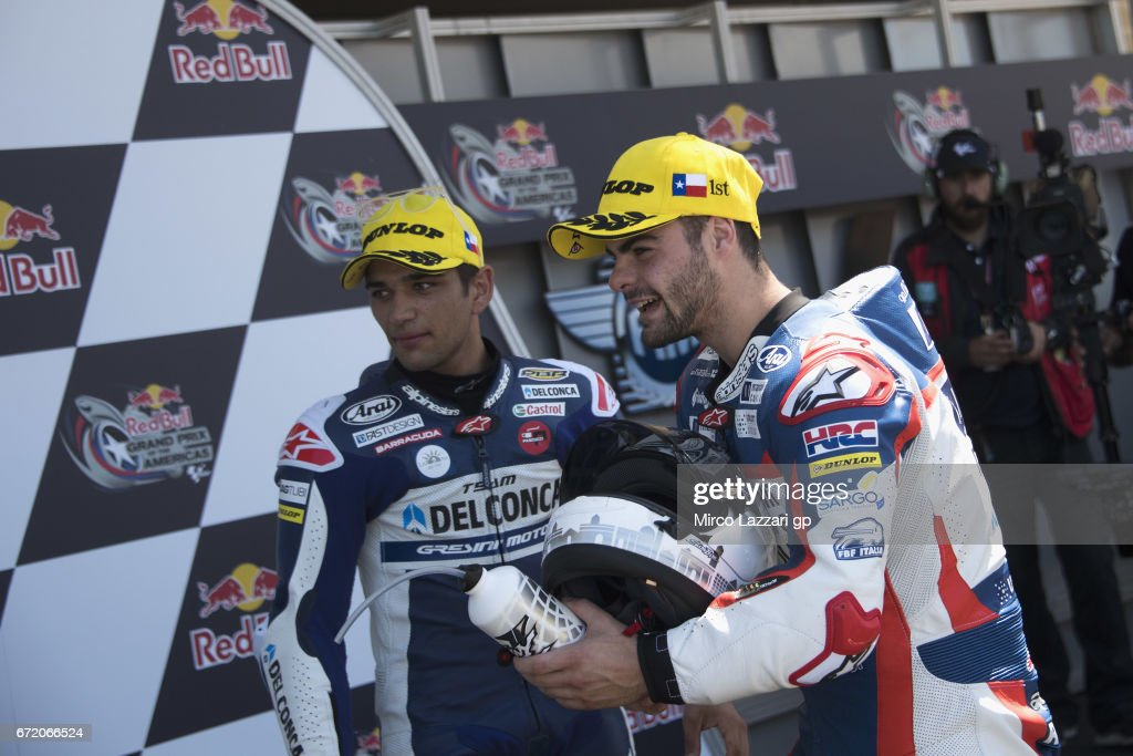 Jorge Martin of Spain and Del Conca Gresini Moto3 and Romano Fenati of Italy and Marinelli Rivacold Snipers Team (R) celebrate under the podium at the end of the Moto3 race during the MotoGp Red Bull U.S. Grand Prix of The Americas - Race at Circuit of The Americas on April 23, 2017 in Austin, Texas.