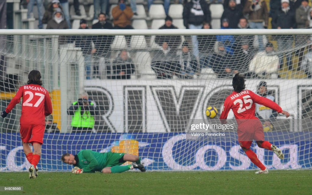 Jorge Martinez (R) of Catania Calcio scores the opening goal from a penalty past goalkeeper <a gi-track='captionPersonalityLinkClicked' href=/galleries/search?phrase=Alexander+Manninger&family=editorial&specificpeople=167082 ng-click='$event.stopPropagation()'>Alexander Manninger</a> of Juventus during the Serie A match between Juventus FC and Catania Calcio at Stadio Olimpico on December 20, 2009 in Turin, Italy.