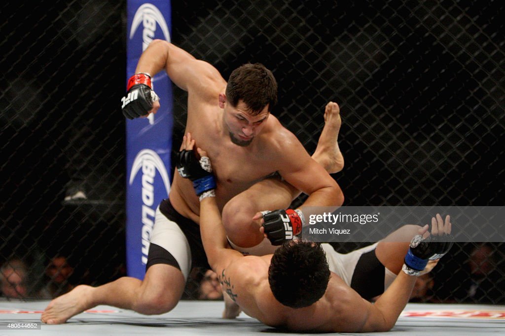 Jorge Masvidal (top) punches Cezar Ferreira in their welterweight bout during the Ultimate Fighter Finale inside MGM Grand Garden Arena on July 12, 2015 in Las Vegas, Nevada.