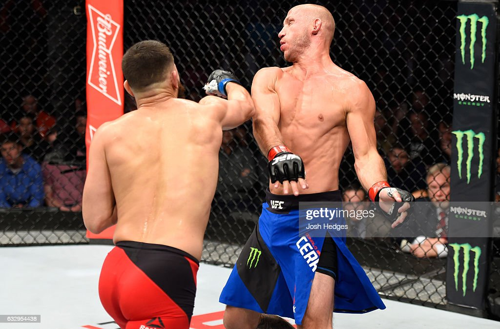 Jorge Masvidal punches Donald Cerrone in their welterweight bout during the UFC Fight Night event at the Pepsi Center on January 28, 2017 in Denver, Colorado.