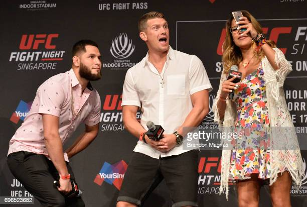 Jorge Masvidal Stephen Thompson and Julianna Pena take a selfie during the UFC Fight Night QA at the Marina Bay Sands on June 16 2017 in Singapore