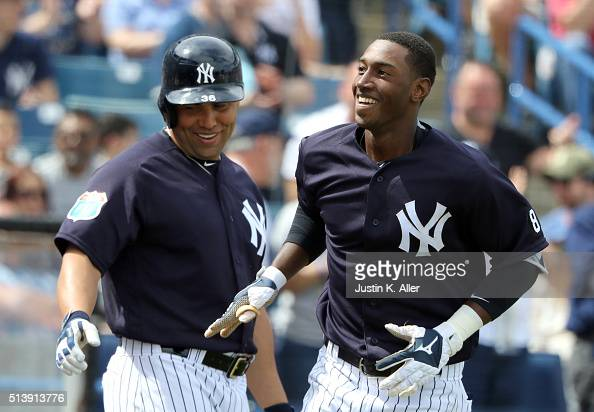 Jorge Mateo of the New York Yankees celebrates with Carlos Beltran after hitting a solo home run in the third inning during the game against the...