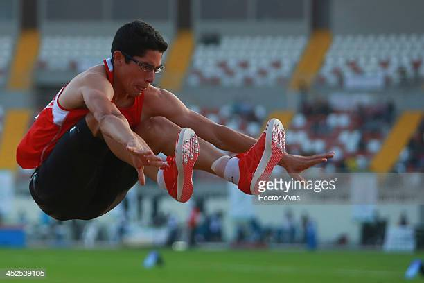 Jorge Mc Farlane of Peru competes in long jump as part of the XVII Bolivarian Games Trujillo 2013 at Chan Chan Stadium on November 29 2013 in...