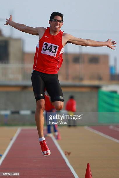 Jorge McFarlane of Peru competes in long jump as part of the XVII Bolivarian Games Trujillo 2013 at Chan Chan Stadium on November 29 2013 in Trujillo...
