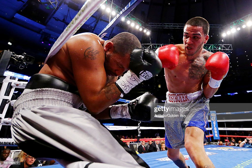 Jorge Melendez (L) connects a a punch while fighting against James Winchester at Madison Square Garden on December 1, 2012 in New York City.
