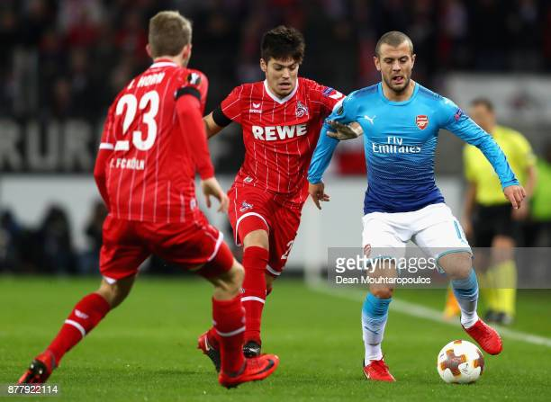 Jorge Mere of FC Koeln and Jack Wilshere of Arsenal battle for possession during the UEFA Europa League group H match between 1 FC Koeln and Arsenal...