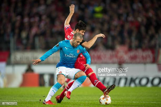 Jorge Mere of Koeln and Jack Wilshere of Arsenal fight for the ball during the UEFA Europa League group H match between 1 FC Koeln and Arsenal FC at...