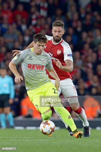 Jorge Mere of Koeln Olivier Giroud of Arsenal battle for the ball during the UEFA Europa League group H match between Arsenal FC and 1 FC Koeln at...