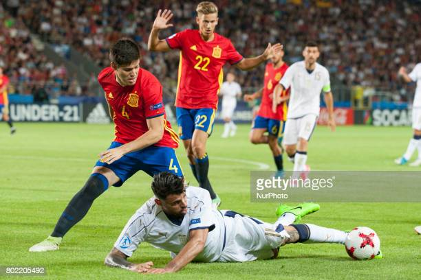 Jorge Mere of Spain and Andrea Petagna of Italy during the UEFA European Under21 Championship SemiFinal match between Spain and Italy at Krakow...
