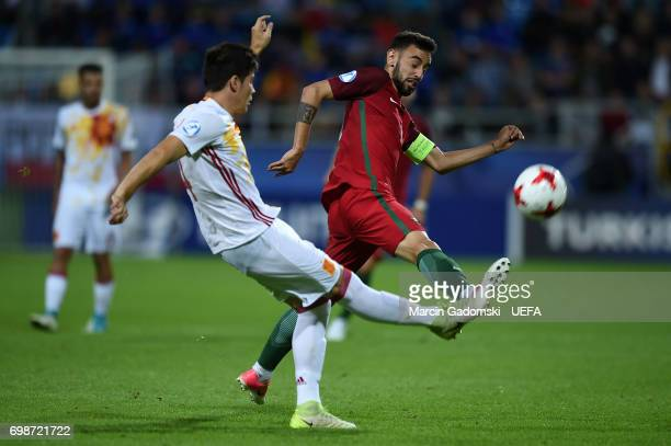 Jorge Mere of Spain and Bruno Fernandes of Portugal during their UEFA European Under21 Championship match on June 20 2017 in Gdynia Poland