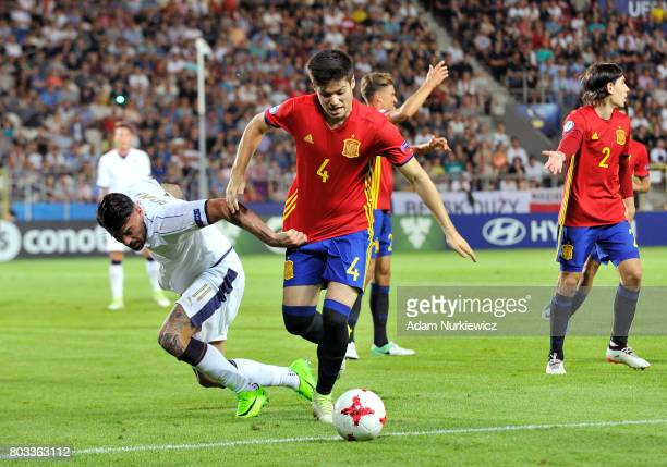 Jorge Mere of Spain is challenged by Andrea Petagna of Italy during the UEFA European Under21 Championship Semi Final match between Spain and Italy...