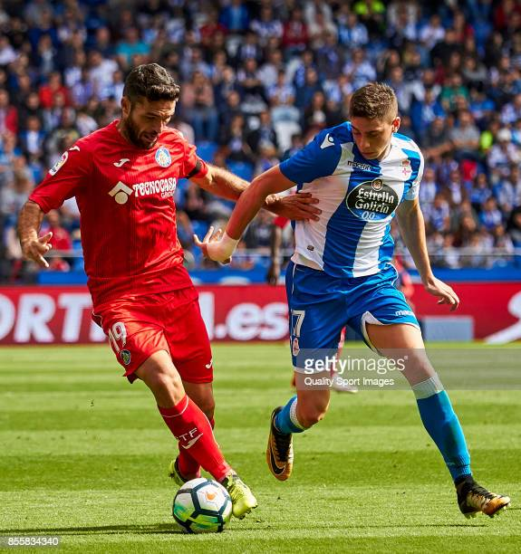 Jorge Molina of Getafe CF is challenged by Federico Valverde of Deportivo de La Coruna during the La Liga match between Deportivo La Coruna and...