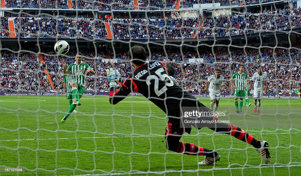 Jorge Molina of Real Betis Balompie scores from a penalty shot their opening goal against goalkeeper Diego Lopez of Real Madrid CF during the La Liga...
