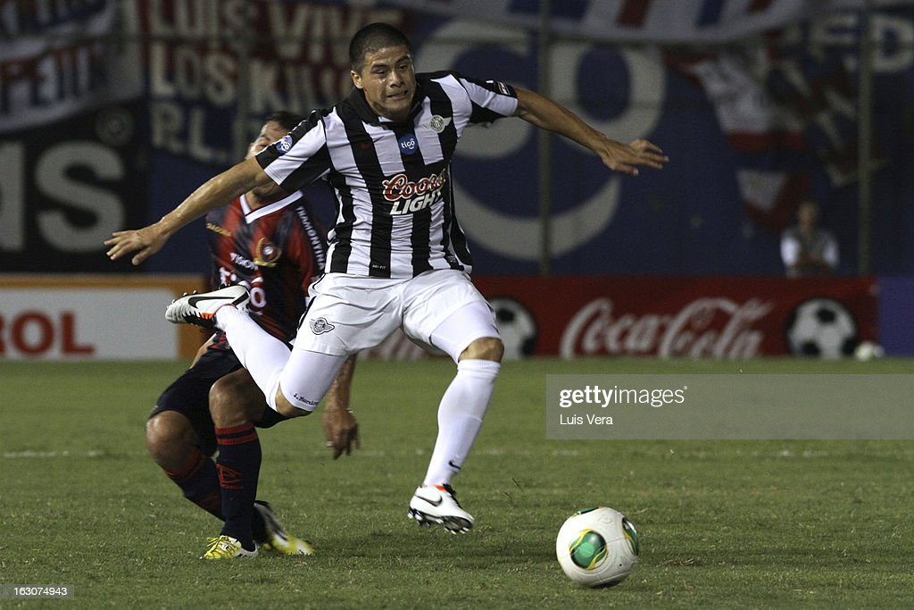 Jorge Moreira of Libertad, fight for the ball during the match between Libertad and Cerro Porteño for the Aperture APF, at Defensores del Chaco on March 03, 2013 in Asuncion, Paraguay.