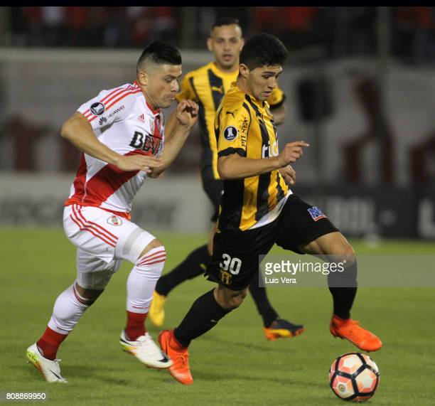 Jorge Moreira of River Plate chases Antonio Marin of Guarani during a first leg match between Guarani and River Plate as part of round of 16 of Copa...