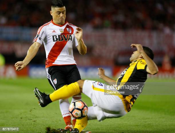Jorge Moreira of River Plate fights for the ball with Luis Alberto Cabral of Guarani during a second leg match between River Plate and Guarani as...