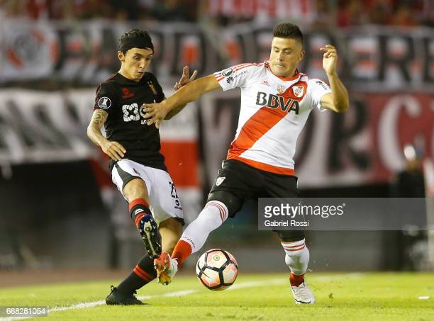 Jorge Moreira of River Plate fights for the ball with Omar Fernandez of Melgar during a match between River Plate and FBC Melgar as part of Copa...